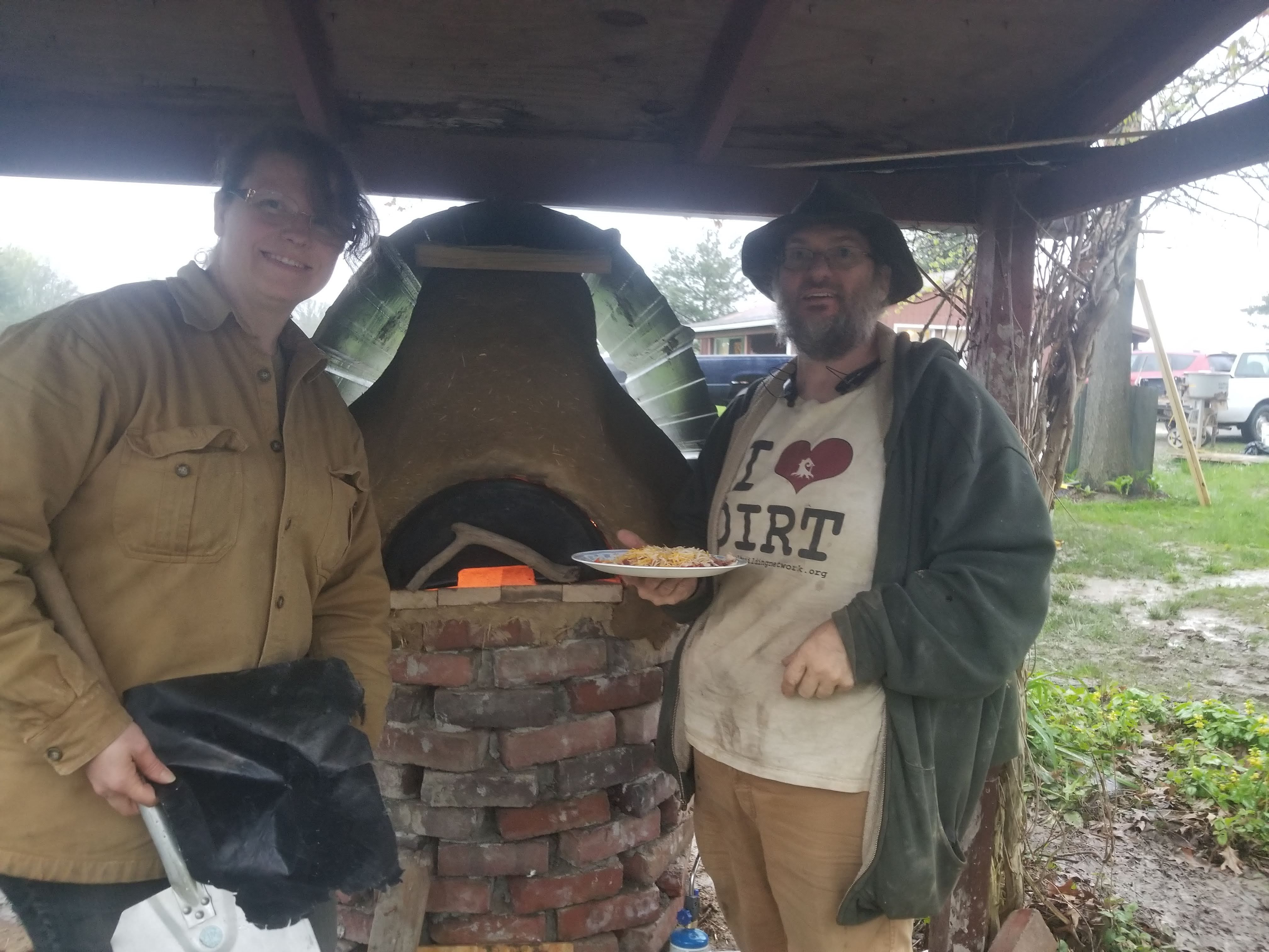 Pizza right out of the earthen cob oven