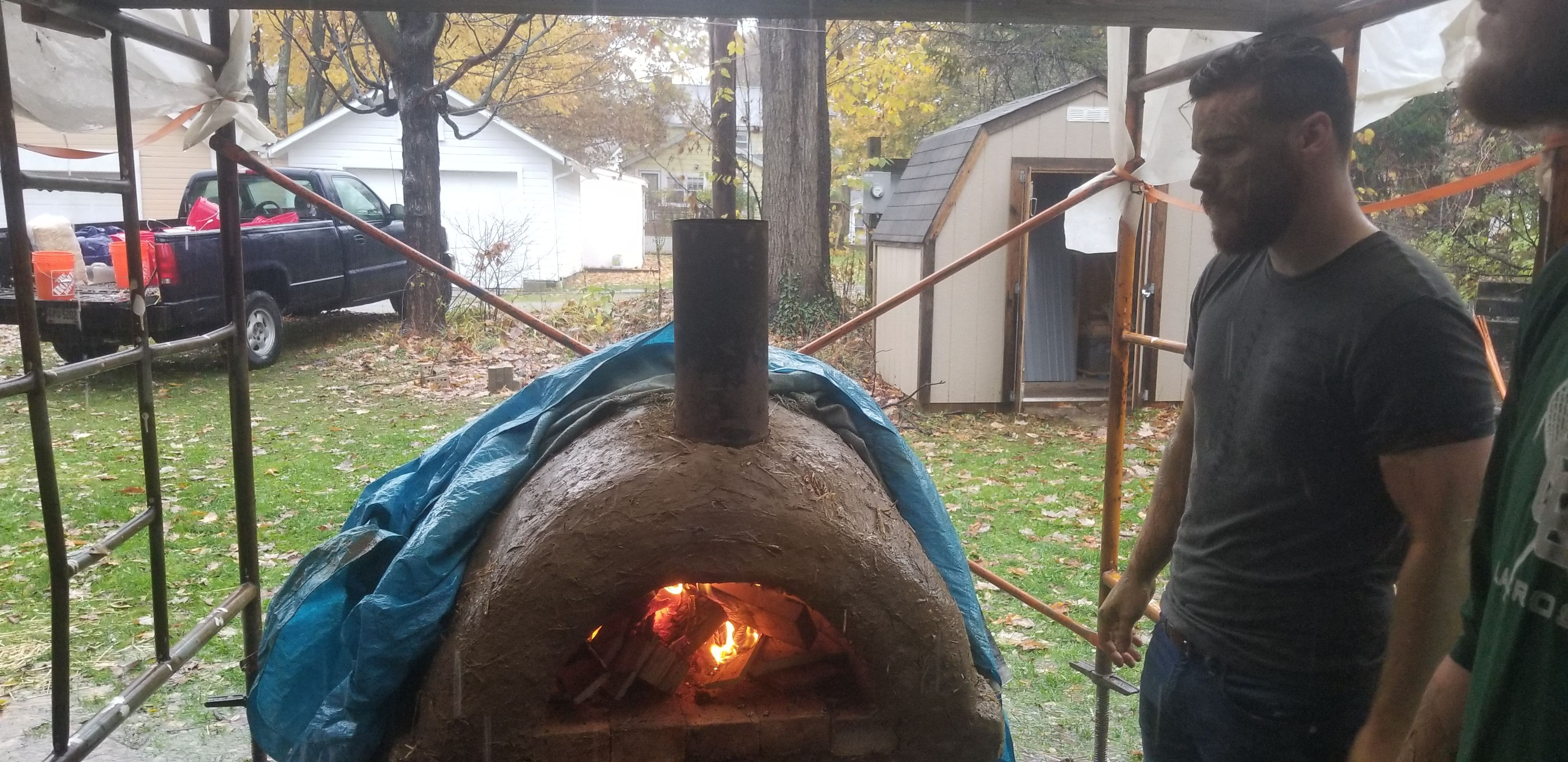 Firing up the Hiram Earthen Cob Oven