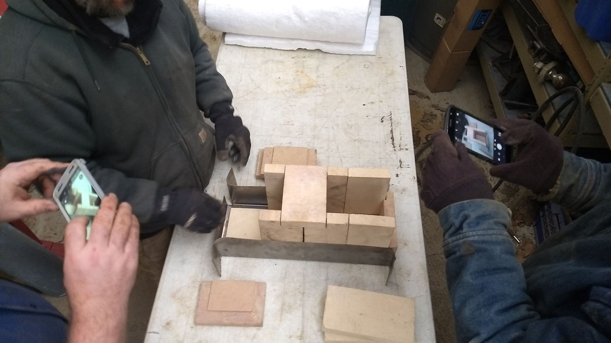 Positioning the bricks for the burn chamber