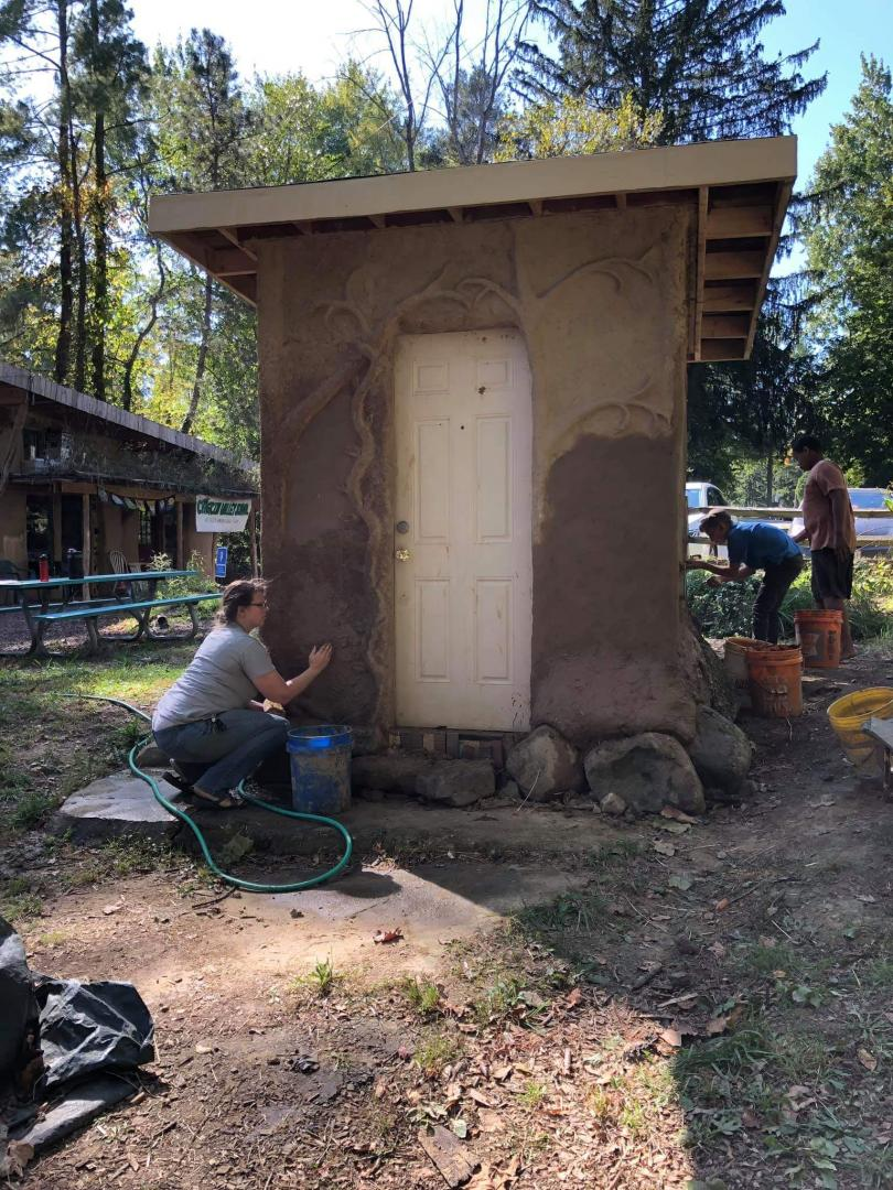Plastering the Wellhouse with Earthen Plaster