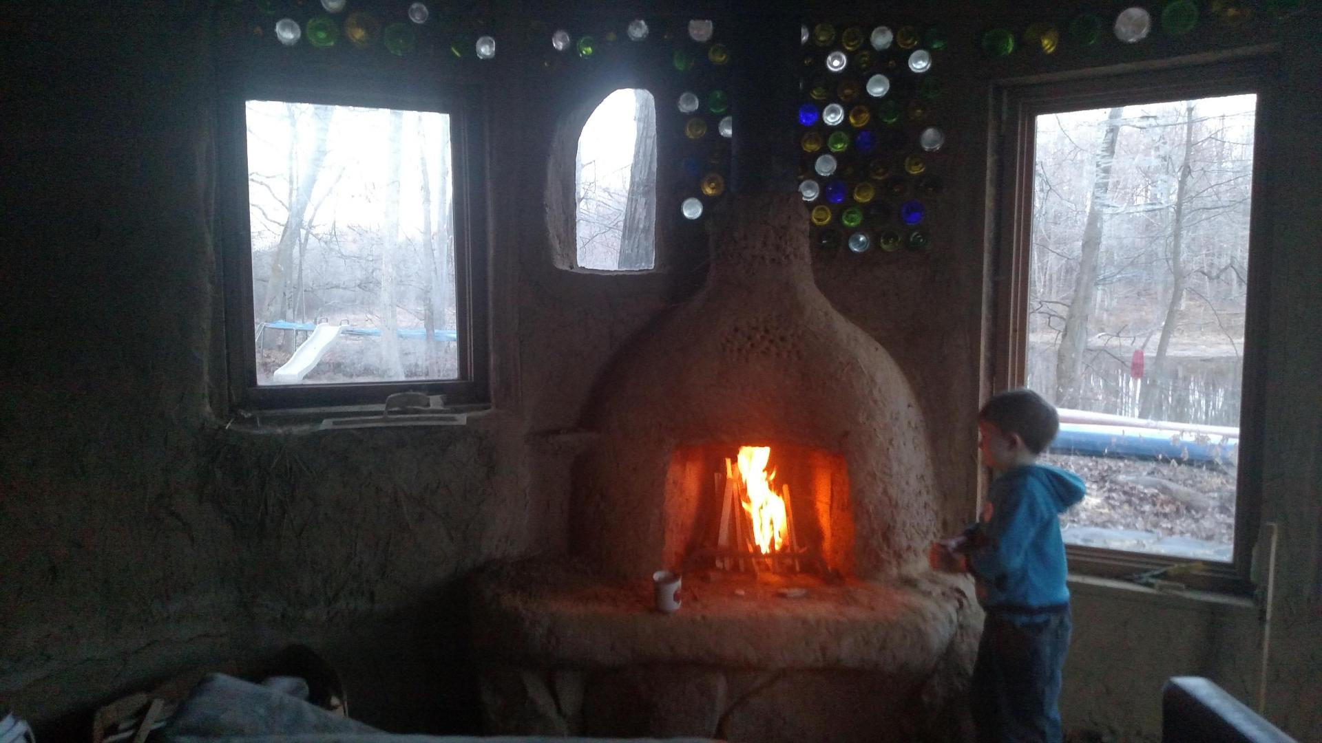Firing up the Cob Rumford Fireplace